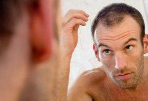 getty_rf_photo_of_balding_man_in_mirror